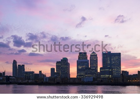 LONDON, UK - APRIL 07, 2015: Canary Wharf London skyline at dusk. Canary Wharf is a major business district located in Tower Hamlets.