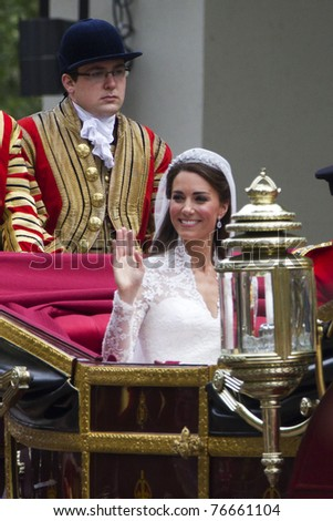 LONDON, UK - APRIL 29:  Kate Middleton ride in a carriage on her way to Buckingham Palace after her wedding on the April 29, 2011 in London, UK