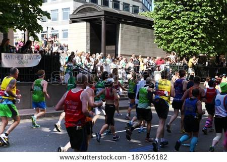 LONDON, UK - APRIL 13, 2014: - London Marathon in Canary Wharf aria, massive sport event for professionals and amateurs sportsmen, Champions League