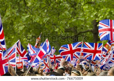 LONDON, UK - APRIL 29: Many people wave flags at Prince William and Kate Middleton wedding on  April 29, 2011 in London, United Kingdom