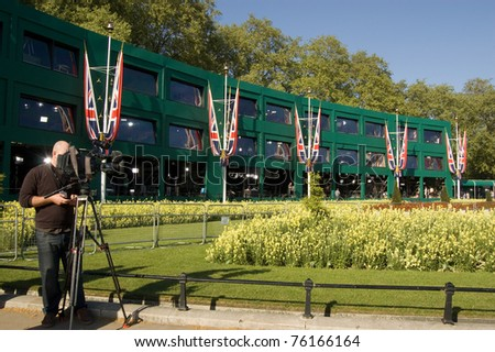 LONDON, UK -APRIL 27: Members of the media broadcast, in preparation of the Royal Wedding, from television studios built for international media on April 27, 2011 outside Buckingham Palace, London, UK.