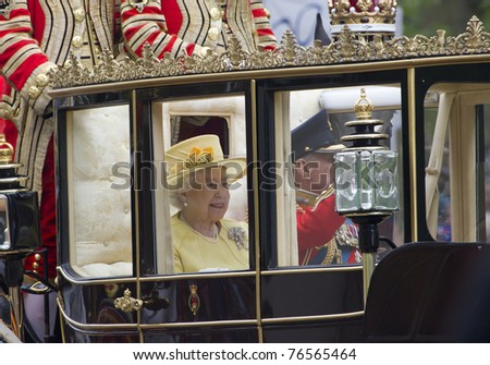 LONDON, UK - APRIL 29: Prince Phillip and the Queen ride in a carriage on there way to Buckingham Palace after the royal wedding of Prince William and Catherine Middleton on April 29, 2011 in London, UK