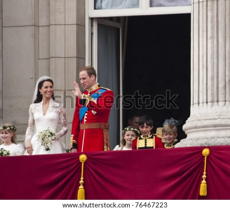 LONDON, UK - APRIL 29: Prince William and Kate Middleton greet the crowd after their wedding, April 29, 2011 in London, United Kingdom - stock photo