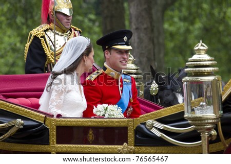 LONDON, UK - APRIL 29: Prince William and Kate Middleton ride in a carriage on there way to Buckingham Palace after their wedding on the April 29, 2011 in London, UK