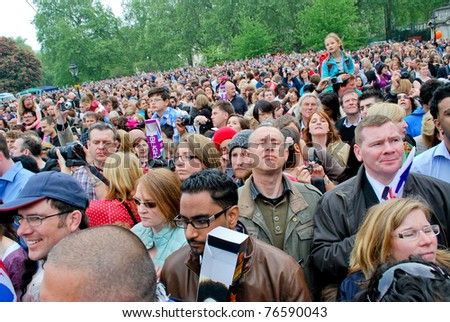 LONDON, UK - APRIL 29: The crowd waiting for the first kiss of the royal couple on the Mall near the Buckingham Palace, April 29, 2011 in London, United Kingdom