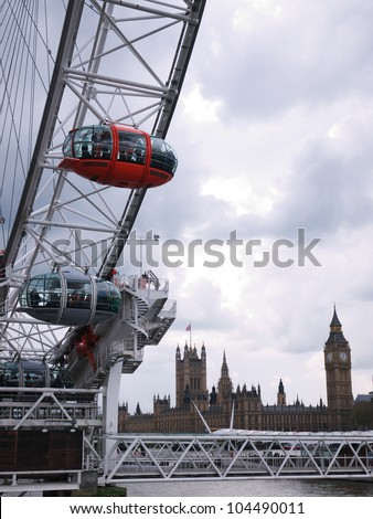 LONDON, UK - APRIL 20: The London Eye along the river Thames and with Houses of Parliament in the background on April 20, 2012 in London. The London Eye is the tallest ferris wheel in Europe.
