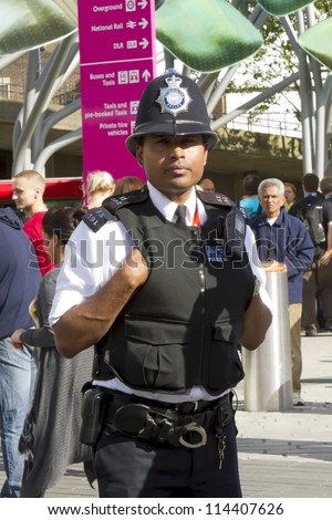 LONDON, UK - AUGUST 5: A London policeman on duty outside Stratford train and metro station on August 5, 2012 in London UK.