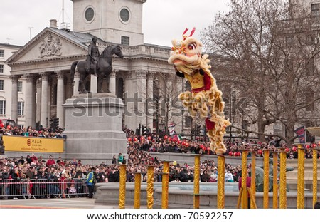 LONDON, UK-FEBRUARY 6: Acrobatic Lion Dancers leap across the poles in Trafalgar Square, during the famous Chinese New Year Celebrations. February 6,2011 in London, UK.
