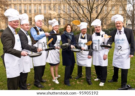 LONDON,UK-FEBRUARY 21: Natasha Kaplinsky with MP team members tossing pancakes, before the 2012 Parliamentary Pancake race, out side the Houses of Parliament on February 21, 2012 in London, UK. - stock photo