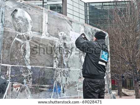 LONDON, UK- JANUARY 15: A unidentified member of the Hungarian Ice Sculpting Team at work in the Annual London Ice Sculpting Festival, on January 15, 2011 in London, UK