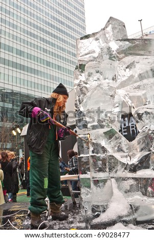 LONDON, UK-JANUARY 15: A unidentified member of the UK Ice Sculpting Team working on their Sculpture for the Annual London Ice Sculpting Festival, Canary Wharf, on January 15, 2011 in London, UK.