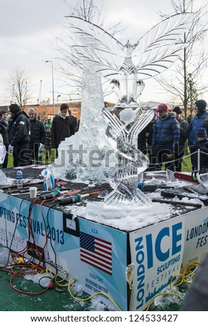 LONDON, UK - JANUARY 13: Artists compete in the freestyle category at the London Ice Sculpture Festival, in Canary Wharf. January 13, 2013 in London.