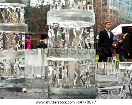 LONDON, UK - JANUARY 15: Ice Sculptures Carved at the  Annual London Ice Sculpture Festival, Held at Canary Wharf. London, January, 15 2010