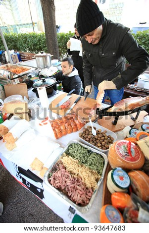 LONDON, UK - JANUARY 13 : Man prepares sausages and cheese at the  International Ice Sculpting Festival  in London on January 13th, 2012