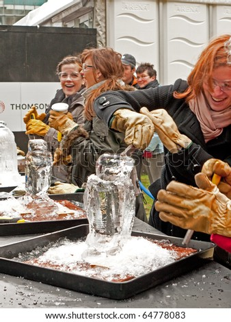 LONDON, UK - JANUARY 15: Members of the Public at Ice Sculpting at the Annual London Ice Sculpture Festival. Canary Wharf, London January, 15 2010