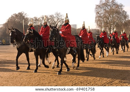 LONDON, UK- JANUARY 19: Members of the Queen's Royal Horse Guards, the Royal Life Guards Regiment, riding to the Changing of the Guard Ceremony at Horse Guards Parade. January 19, 2011 in London, UK.