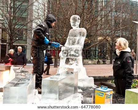 LONDON, UK - JANUARY 15: Team Members Work on Their Ice Sculpture for the Annual London Ice Sculpture Festival Competition, Canary Wharf. London, January 15 2010