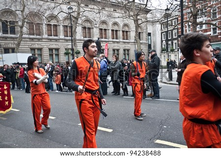 LONDON, UK-JANUARY 29: Unidentified Chinese Martial Arts team members take part in the parade, part of the famous London celebrations for the year of the dragon, January 29, 2012 in London UK - stock photo