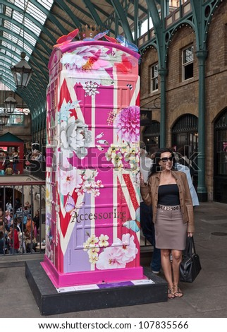 LONDON,UK-JULY 15:  Accessorize\'s  distinctly English design in Covent garden. BT Art Box an art installation and charity fundraiser using the iconic red phone box design. July 15, 2012 in London UK