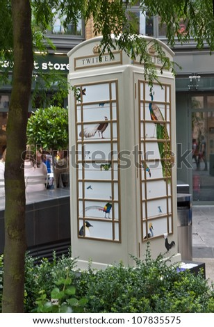 LONDON,UK-JULY 15:  Artist Rebecca Campbell\'s design Twitter for BT Art Box an art installation and charity fundraiser using the iconic red phone box design. July 15, 2012 in London UK