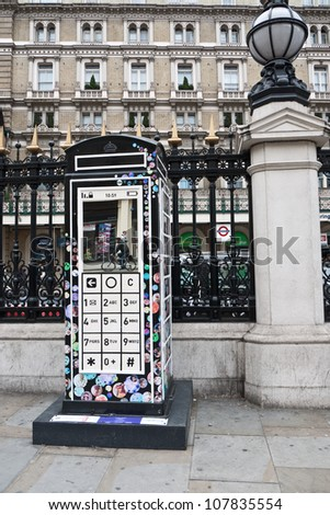 LONDON,UK-JULY 15: Designer Fred Butler\'s Mobile Phone design for  BT Art Box, an art installation and charity fundraiser using the iconic red phone box design. July 15, 2012 in London UK