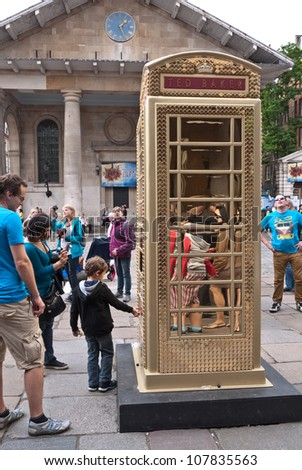 LONDON,UK-JULY 15:  Designer Ted Baker\'s Ding a Bling Box in Covent garden. BT Art Box an art installation and charity fundraiser using the iconic red phone box design. July 15, 2012 in London UK