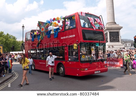 LONDON, UK- JULY 2: London bus and participants dressed for the annual London Gay Pride Parade, drive past Trafalgar Square to the end of the route. July 2, 2011 in London UK.