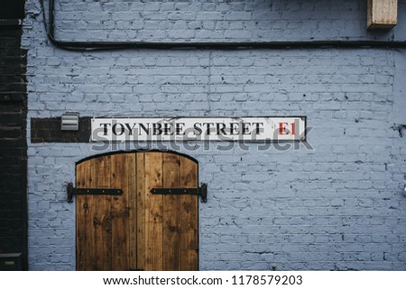 London, UK - July 22, 2018: Toynbee Street name sign on a wall in Spitalfields, a lively East End London area, home to artists, creatives and a large Bangladeshi community. #1178579203