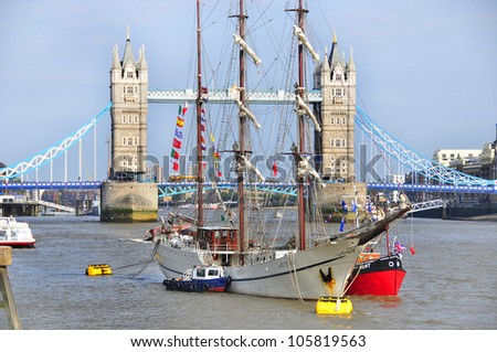 LONDON, UK-JUNE 1: Boats decorated with flags and bunting for the Queen's Diamond Jubilee celebrations, with the Tower Bridge in background. June 1, 2012 in London UK