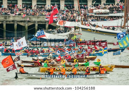 LONDON, UK - JUNE 3:  Colorful flotilla of rowing boats, part of the Queen Elizabeth II Diamond Jubilee Pageant on the River Thames, London, UK on June 3, 2012