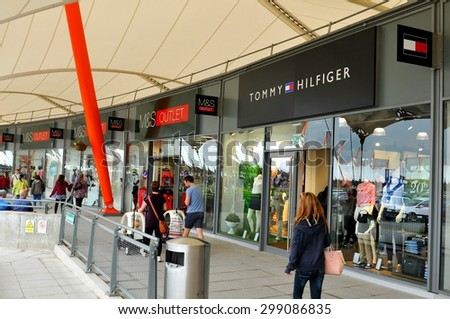 London, UK - June 14, 2015: Detail of the entrance to a Tommy Hilfiger store. Tommy Hilfiger is a famous American fashion designer for men, women and children apparel, sportswear, etc.