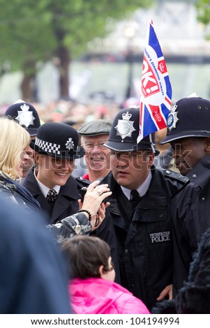 LONDON, UK - JUNE 03: Police join in the fun for the Queens Diamond Jubilees Pageant on the June 03, 2012 in London, UK