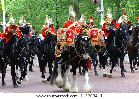 LONDON, UK - JUNE 02: Queen's guards during Trooping the Color ceremony parade on the Mall and at Buckingham Palace, on June 02, 2012 in London.