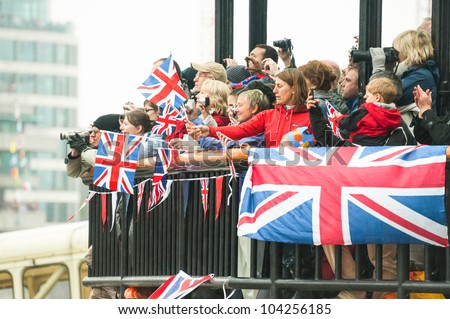 LONDON, UK - JUNE 3:  Rainy day flag waving and photography by the public during the Queen Elizabeth II Diamond Jubilee celebrations in London, UK on June 3, 2012