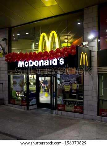 LONDON, UK - JUNE 15, 2013: The outside entrance of a Mcdonalds store in London on June 15 2013