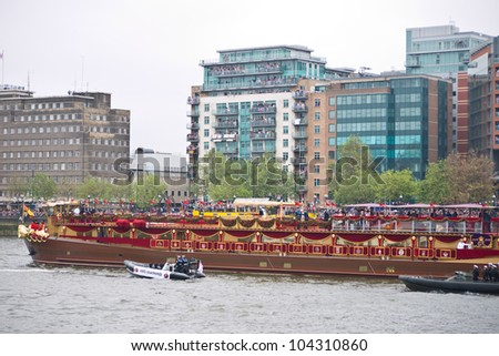 LONDON, UK-JUNE 3: The Spirit of Chartwell the Royal Barge carries the Queen and Royal family in the 1000 strong flotilla in the Diamond Jubilee Pageant on the River Thames.June 3, 2012 in London UK.