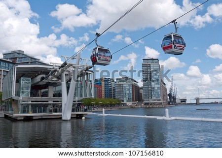 LONDON, UK-JUNE 30:Visitors travel on Emirates Air Line cable cars. The service is the UK's first urban cable car running across the Thames from the O2 to the Excel centre  June 30, 2012 in London UK