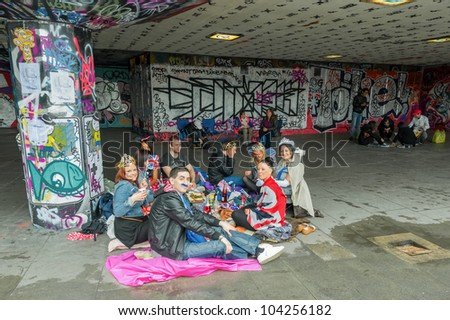 LONDON, UK - JUNE 3:  Youth enjoying a picnic amongst the urban art on the South Bank during the Queen Elizabeth II Diamond Jubilee celebrations in London, UK on June 3, 2012