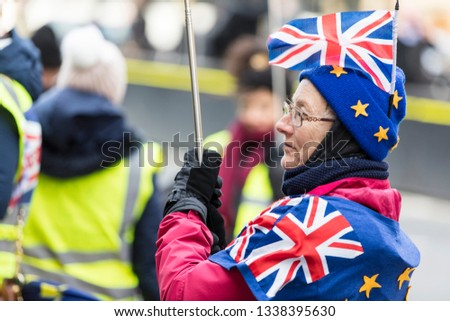 LONDON, UK - March 13, 2019: Anti brexit supporters protesting in Westminster #1338395630
