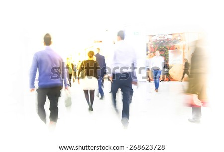 LONDON, UK - MARCH 31, 2015: Business people moving blur. People walking in rush hour. Business and modern life concept