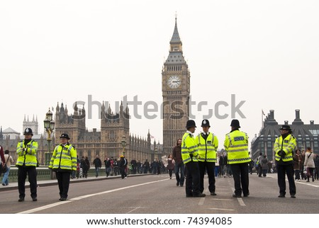 LONDON, UK - MARCH 26: Police officers during the march in central London against public spending cuts, March 26, 2011 in London, United Kingdom