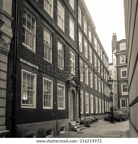 LONDON, UK - MAY 9, 2006: A retro styled sepia image of one of the small pedestrian streets that still display signs of Victorian London in the Temple area.