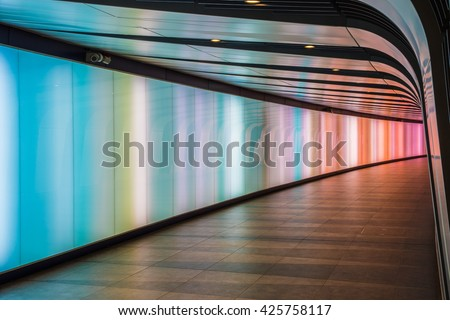 London, UK - May 20, 2016 - King's Cross futuristic looking tunnel, the 90 meters long curved pedestrian tunnel features an LED integrated lightwall #425758117