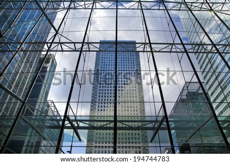 LONDON, UK - MAY 14, 2014: Office buildings modern architecture of Canary Wharf aria  the leading centre of global finance - Shutterstock ID 194744783