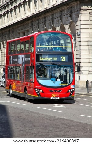 LONDON, UK - MAY 13, 2012: People ride London Bus in London. As of 2012, LB serves 19,000 bus stops with a fleet of 8000 buses. On a weekday 6 million rides are served.