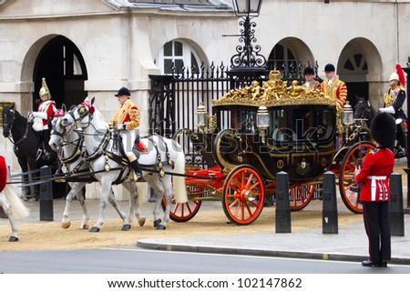 LONDON, UK - MAY 09: The Queen & Prince Phillip pass through horse guards parade on the way to the state opening of parliament on the MAY 09, 2012 in London, Uk