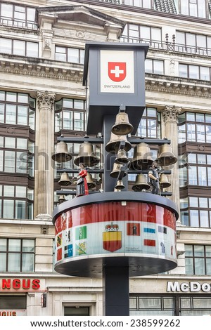 LONDON, UK - MAY 31, 2013: View of Swiss glockenspiel clock (erected 1985) on Leicester Square in London. Under the clock have 27 bells and figures of traditional Swiss Alpine farmers.