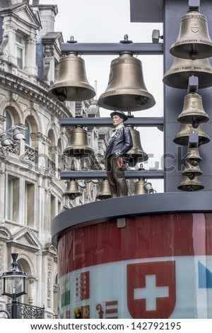 LONDON, UK � MAY 31: View of Swiss glockenspiel clock (erected 1985) on Leicester Square, on May 31, 2013 in London, UK. Under the clock have 27 bells and figures of traditional Swiss Alpine farmers.