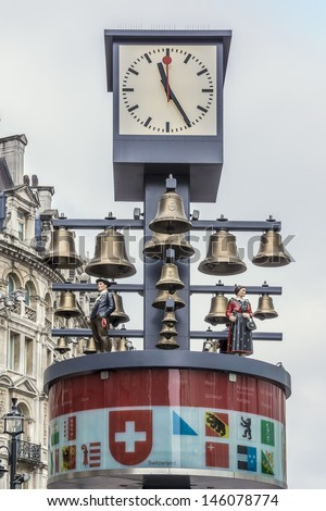 LONDON, UK - MAY 31: View of Swiss glockenspiel clock (erected 1985) on Leicester Square, on May 31, 2013 in London, UK. Under the clock have 27 bells and figures of traditional Swiss Alpine farmers.