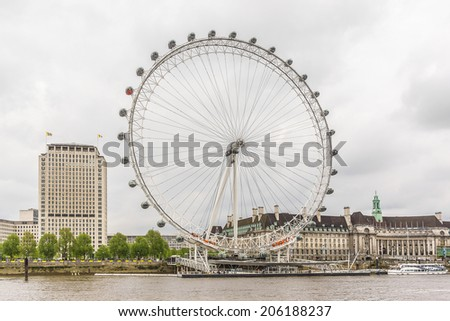 LONDON, UK - MAY 30, 2012: View of the London Eye at sunset. London Eye (135 m tall, diameter of 120 m) - a famous tourist attraction over river Thames in the capital city London.